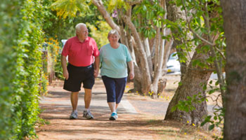 overweight couple walking